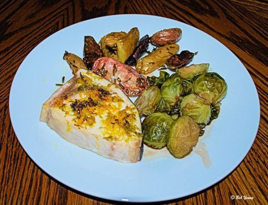 Dinner is plated! Broiled Lime and Orange Swordfish Herb Roasted Idaho Fingerling Potatoes Balsamic and Current Juice Reduction with Brussels Sprouts