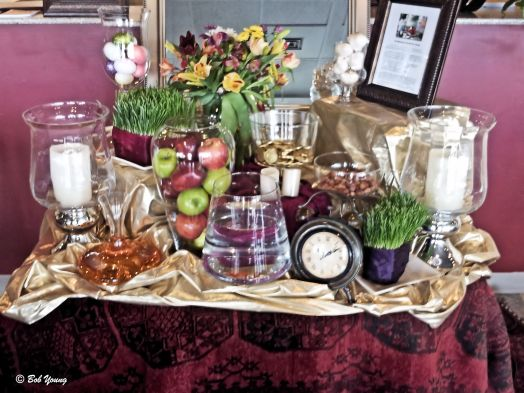 """Nowruz celebrations last for many days, during which people visit with relatives and friends. Gifts are exchanged and parties are hosted. There is even a special display [pictured here] known as ""Haft Seen"" (the Seven 'S's) with items beginning with the Persian letter for ""s"" that have special symbolic value."" (Kabob House)"