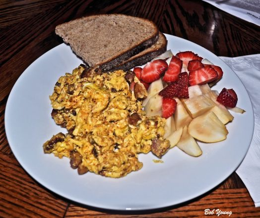 Our House - Dinner Scrambled Eggs with Pancetta Fresh Pear and Strawberry Mixed Fruit  Acme Bakery Rye Toast