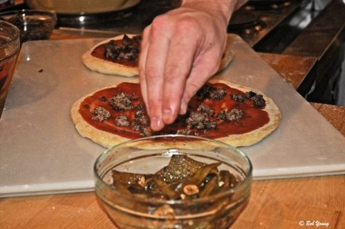 Prepping the Sausage and Pepper Pizza.