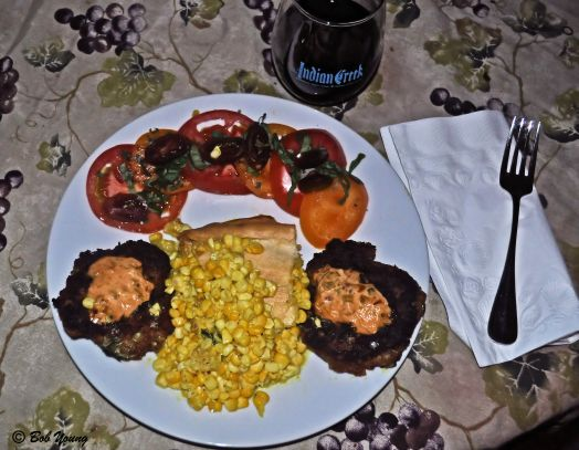 It may have been National  Corn Fritter Day, but we decided on a family favorite - Corn Pie. Here was our menu: Corn Pie Scallop Cakes Sliced Red, Yellow and Zebra Tomatoes with Basil and Oregano Shreds 2009 Sawtooth Petite Sirah This was a YUM dinner! Comfort food.