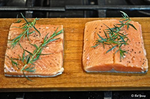 Copper River salmon on the cedar planks and ready for the grill. Salt, pepper and fresh tarragon and that's all!