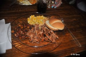Plated pulled pork, homemade beans and corn pie.