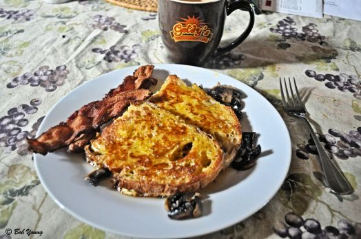 Acme Bake Shop Sourdough and Potato Bread French Toast Sauteed Mushrooms on the side Crispy Falls Brand Bacon and Coffee. An awesome breakfast.