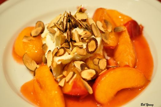 "Sauteed Pluots with Mascarpone and Almonds Ok. What are ""pluots""? Good question. They are a mix of apricots and red plums. Also know in some places as Red Apricots. Slightly sweet. Slightly tart. A yummy dessert!"