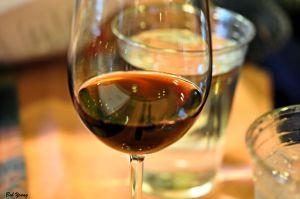 Silverware, A Menu and A Glass of Wine