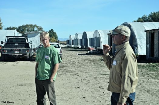 Tim Sommer and his son Mike, owners of the Purple Sage Farms, talk to the crowds that were there.ike3 loves to work on and with the  land. They use only their own compost and their water supply is from the Payette River.