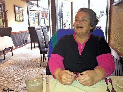 Robin is enjoying the ambiance and talking wine to the distributor and our Server, Chris.