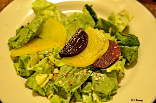 Salade de Bettraves et noisette Butter lettuce topped with gold and red beets, toasted hazelnuts and served with a mustard vinaigrette