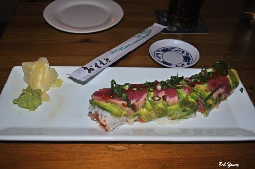 Jackie B  Spicy Tuna & Yellowtail wrapped in Avocado & seared Ahi, topped with Sriracha