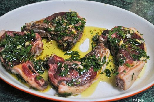 4 med laqmb chops, 1/4 c Olive Oil, Salt and Pepper to rare, 1/2 c Italian Parsley chopped, 1 lg clove Garlic, minced, Zest of 1 Lemon. Mix altogether and mash the herbs. Pour over the chops and let marinate for 1 hour. Cook in a 350 degree oven for 20 minutes.