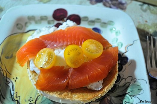 Poached Meadowlark Farm Egg Lox Heirloom Yellow Tomato on a Sesame Bagel