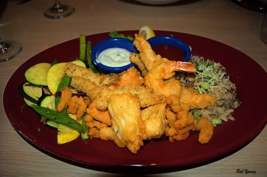 Captain Alex's Seafood Platter A medley of cod, salmon, halibut, mahi mahi, Jumbo shrimp, calamari and clams battered and deep fried to perfection. Served with chef's choice sautéed vegetables and wild rice 18.99