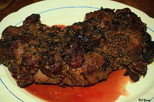 The cooked lamb is resting to redistribute the juices.
