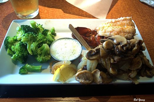 Our Steak and Lobster dinners. Wonderful mushrooms and onions.  And broccoli. You make the choices for steak toppings, rareness of the steak and vegetable selections. Robin had a baked potato with all the fixins'.