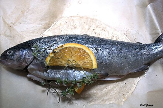 Stuff the trout with 5 sprigs of Lemon Thyme and 2 sprigs of French Thyme.  Add 1 slice of orange. For generating the steam, we used a\ 2011 Dusted Valley Vineyards Pinot Gris. About 2 Tablespoons.