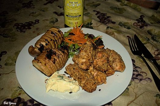 Housemade Salmon Fish Sticks Special Dipping Sauce Fanned Baked Sw2eet Potato with Garlic Butter Fresh Green Garden Salad wit5h Carrot Threads Full Sale LTD Lager