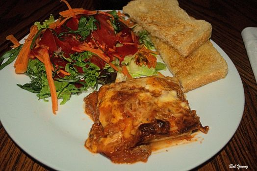 Lasagna Fresh Salad Greens with basil and carrot threads Acme Bake Shop Toasted Sourdough with garlic