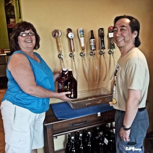 Tommy and Michelle show off the new Growler Bar.
