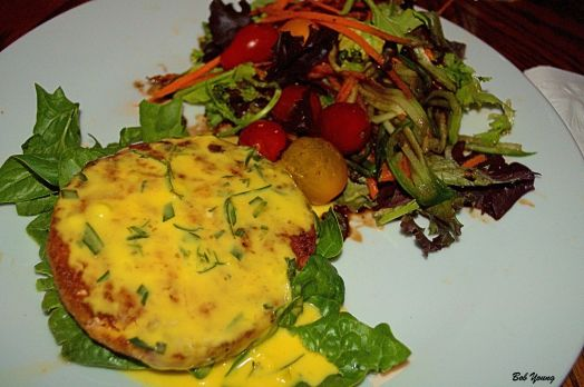 Braised Salmon Patty On Spinach Bed with Herbed Hollandaise Fresh Garden Salad with Carrot and Cucumber Threads and Heirloom Tomatoes Lemon Olive Oil and Balsamic Dressing