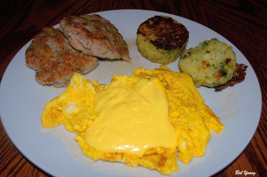 Two Meadowlark Farms Scrambled Eggs with Housemade Hollandaise Sauce Housemade Sausage Patties Broccoli and Potato Cakes