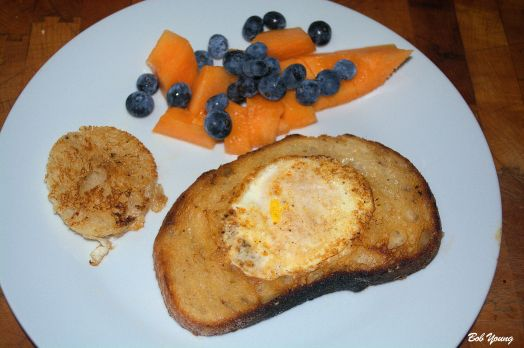 Cowboy Eggs (Eggs in Toast) Fresh Cantaloupe and Blueberries