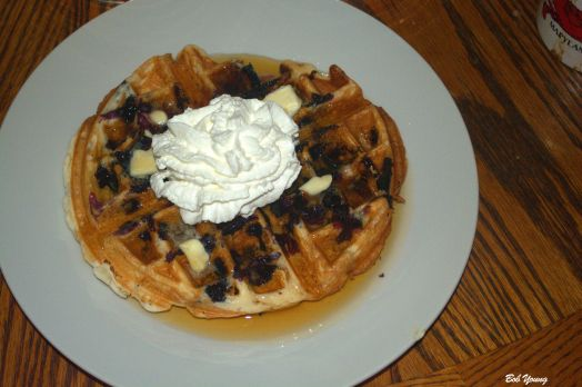 Blueberry and Bacon Waffle with Whipped Cream and fresh Maple Syrup