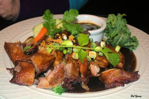 Chef's Special Honey Crispy Duck Half duck marinated sauce and then roasted. Served with special honey sauce on top a bed of vegetables and jalapeno soy on the side.  $13.95
