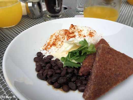 Moroccan Black Beans and Poached Eggs Organic Idaho black beans, Earthly Delights Farm heirloom Hopi blue corn polenta, preserved Meyer lemon crème fraîche, Meadowlark Farm poached eggs