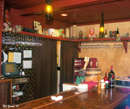 The bar area that is also a waiting area. There is a shelter outside that the over flow can congregate.