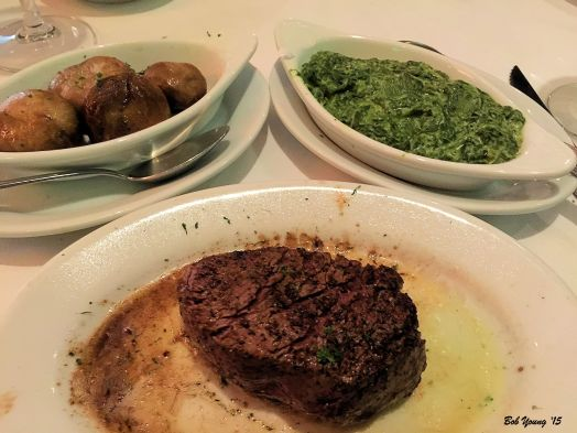 """Petite Filet. """"USDA Prime served sizzling on a 500° plate - every bite is as delicious as the first."""" This was delicious! Loved the way the sides came in their own bowls. The Creamed Spinach was super good wsith a touch of nutmeg. The Mushrooms accompanied the steak very well. Robin had Garlic Mashed Potatoes."""