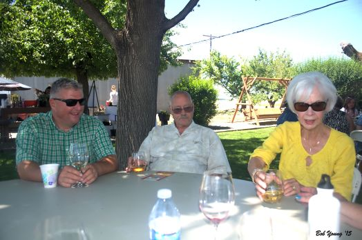 Gregg Algers, Winemaker at Houston Winery,  Larry and Elaine Gibson, TVWS members all enjoy the pizza and the wine.