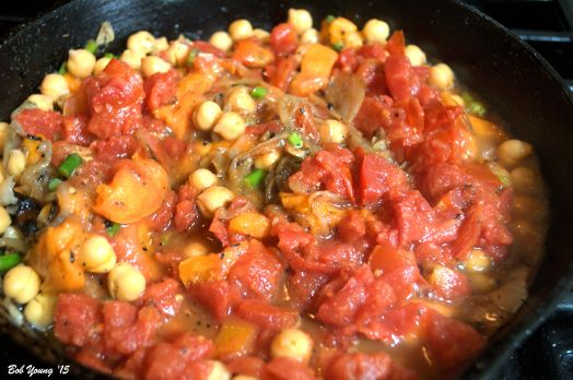 Chopped tomato is added to the pot. Let cook until warmed through.