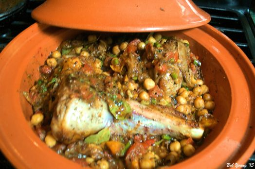 Add the vegetable mixture to the tagine. Taste and adjust as necessary. Place the lamb shanks into the vegetables. After 1 hour, it should look like this.