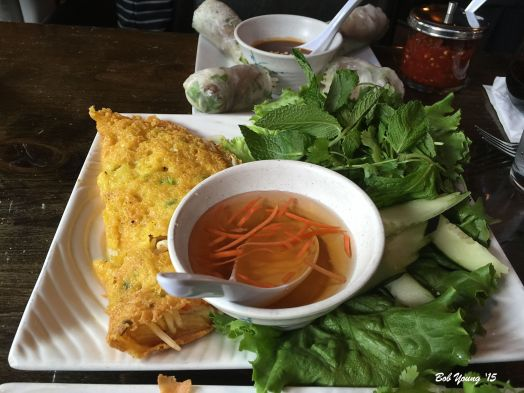 Sizzling Saigon Crepe Oversized crisxpy crepe made with coconut milk, tumeric and rice flour, filled with chicken, shrimp, onion and bean sprouts. Wrap in lettuce and herbs. A non-spicy Vietnamese dipping sauce is available.