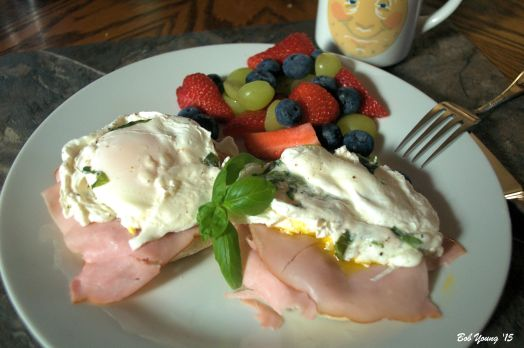 Poached Meadowlark Farms Eggs with Basil Black Forest Ham, Toasted English Muffin  Patriotic Fruit Mix
