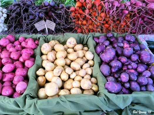 Same photo as in the header, but delightful colors and products. Love those blue potatoes. Now all we need are some orange colored spuds!
