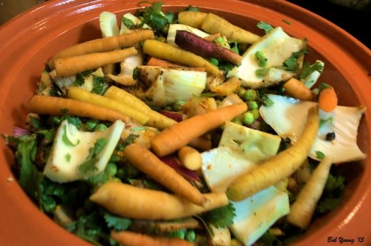 Using the recipe link above, the vegetables are cut and placed in the tagine along with all spices.