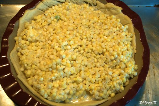 12 ears of corn off the cob. Salt and pepper to taste. About 1 cup of whole milk and about 2 Tablespoons of butter broken up. About 2 Tablespoons of flour. All mixed together in a large bowl then poured into a partial baked pie crust.
