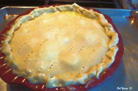 A second pie crust is put on top. Pierce it with a fork and butter the top liberally.