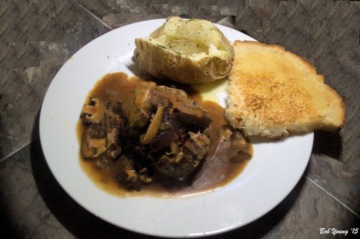 Salisbury Steak with mushroom dark gravy Baked Potato with butter and chives Toasted Basque Bread