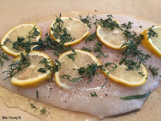 The flounder is set in the parchment with lemonn slices, limoncello, Texas tarragon (which has a slight bite to it compared to the French tarragon) and salt and pepper.