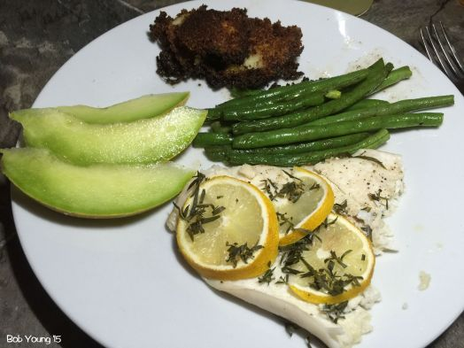 Flounder en Papillote Fresh Idaho Honeydew Melon Slices Potato Croquettes Fresh Green Beans with Brown Butter
