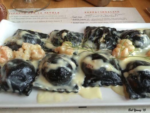 Black Ravioli... stuffed with West coast lobster & fontina, butter poached shrimp & lemon-fennel-thyme infused local Cloverleaf cream sauce