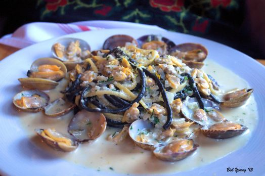 Tuxedo' Linguine {gf}... squid ink & orange zest infused linguine, ÀLAVITA clam sauce, chili flake & Manila clams