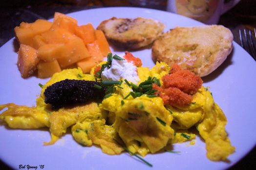 Scrambled Eggs with Chives, Lumpfish Caviar, Sour Cream and Herring Red Row. Fresh Idaho Cantaloupe and Toasted English Muffin