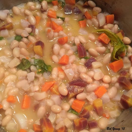 Side dish of white beans, heirloom carrots and baby turnips. This accompanies the dinner very well.