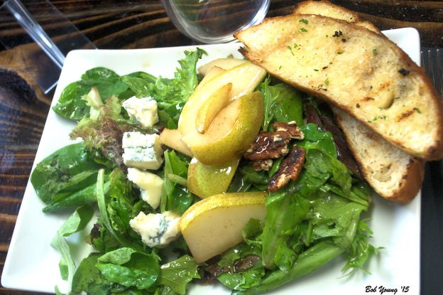 Parma Ridge House Salad Mixed greens with apple cider vinaigrette, Bleu cheese and poached pear with grilled bread