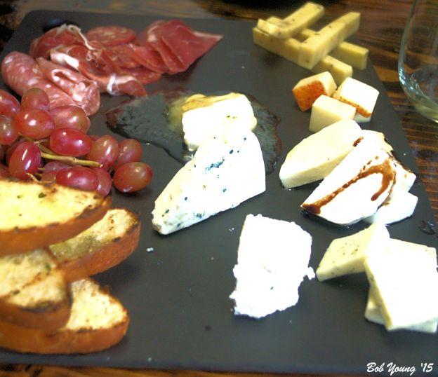 Cheese and Salami Platter smoked provolone, Boursin, dill Havarti, muenster, fresh mozzarella, warm brie and bleu cheese with dry salami and fresh baked bread