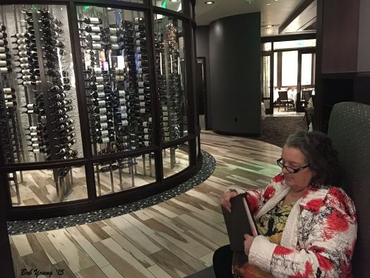 Robin is checking the extensive wine selection.